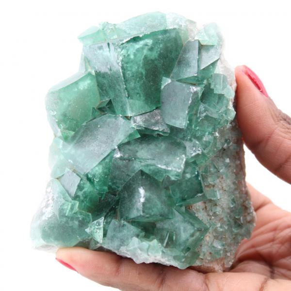 Kubieke kristallen van groen fluoriet op massief fluoriet
